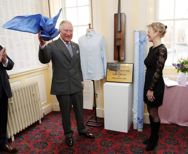 Prince Charles unveils a commemorative plaque to mark his visit at the Emma Willis LTD factory on Feb. 17, 2020 in Gloucester, England.
